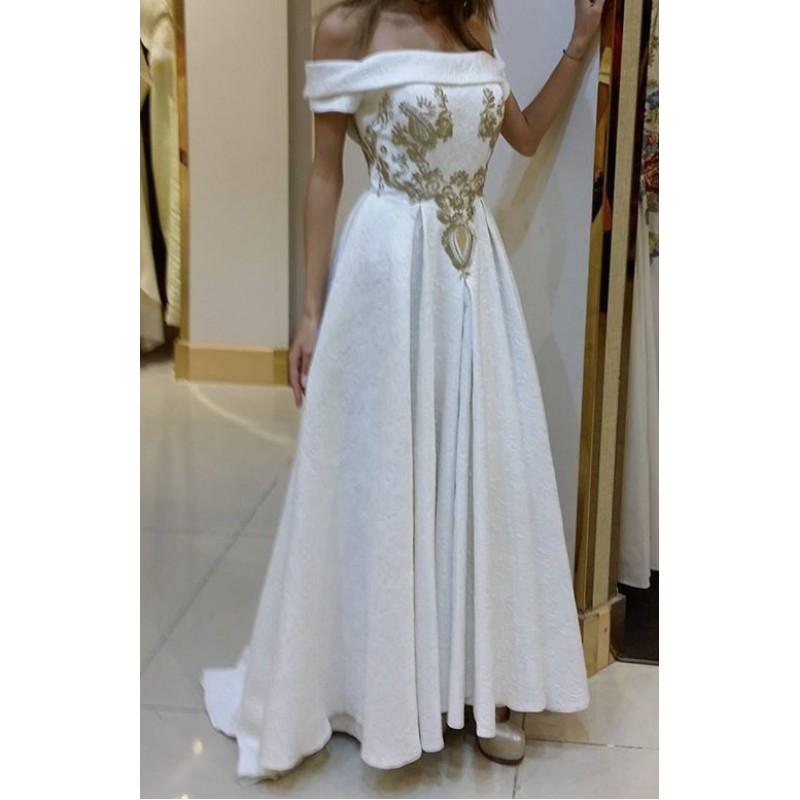 فستان من المصممة إيمان السحيم